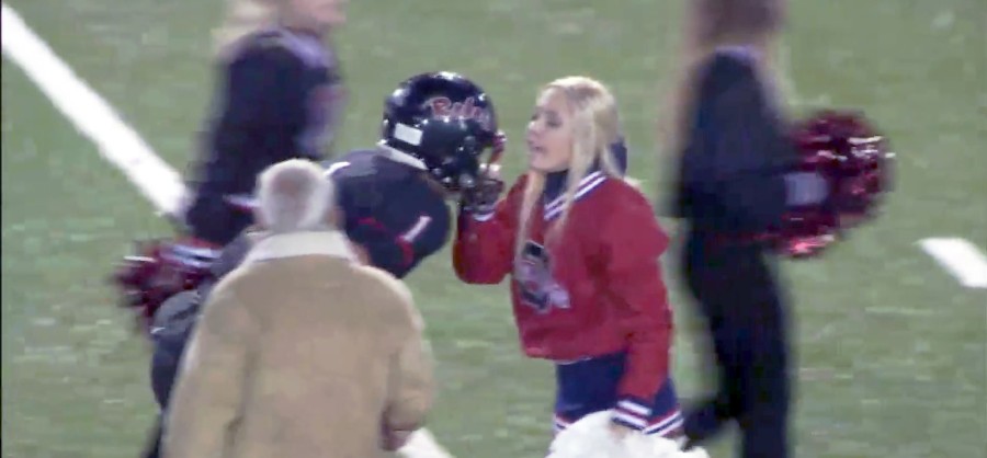 VIRAL VIDEO: Cheerleader Grabs Facemask